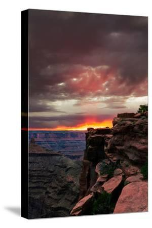 Red sunset with moody clouds and red rock canyons in Dead Horse Point State Park near Moab, Utah-David Chang-Stretched Canvas Print