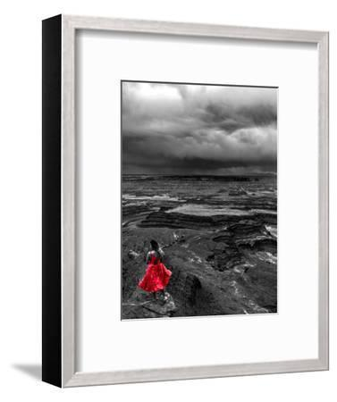 Dark storm clouds over Dead Horse Point State Park with girl in red dress standing near the cliff-David Chang-Framed Photographic Print