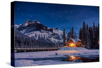 Emerald Lake Lodge in Banff, Canada during winter with snow and mountains at night with starry sky-David Chang-Stretched Canvas Print