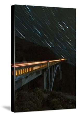 Star trails and light trails over the Big Sur's Bixby Creek Bridge near Monterey, California-David Chang-Stretched Canvas Print