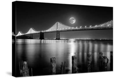 Super full moon rising in San Francisco Embarcadero pier over the Bay Bridge in the evening-David Chang-Stretched Canvas Print