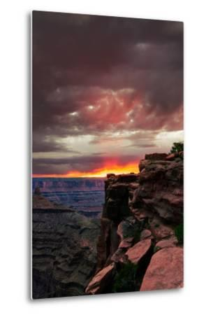 Red sunset with moody clouds and red rock canyons in Dead Horse Point State Park near Moab, Utah-David Chang-Metal Print