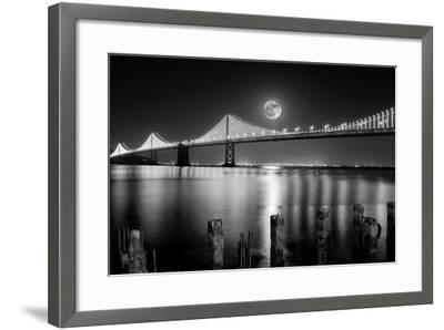 Super full moon rising in San Francisco Embarcadero pier over the Bay Bridge in the evening-David Chang-Framed Photographic Print