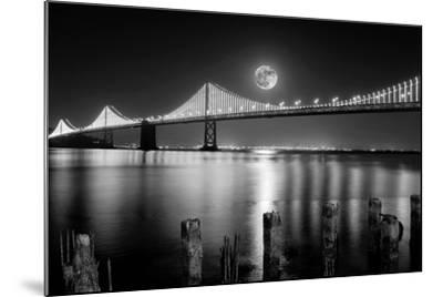 Super full moon rising in San Francisco Embarcadero pier over the Bay Bridge in the evening-David Chang-Mounted Photographic Print