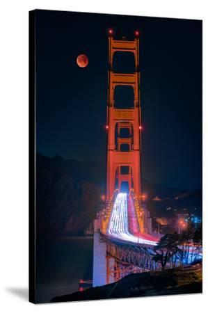 Full blood red moon rising over the Golden Gate Bridge in San Francisco, view from Battery Cranston-David Chang-Stretched Canvas Print