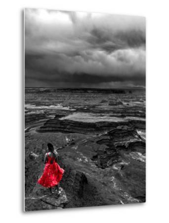 Dark storm clouds over Dead Horse Point State Park with girl in red dress standing near the cliff-David Chang-Metal Print