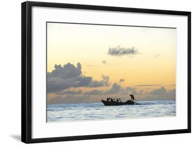 Seine fisherman lay their nets from a boat in Castara Bay in Tobago at sunset, Trinidad and Tobago-Alex Treadway-Framed Photographic Print