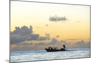 Seine fisherman lay their nets from a boat in Castara Bay in Tobago at sunset, Trinidad and Tobago-Alex Treadway-Mounted Photographic Print