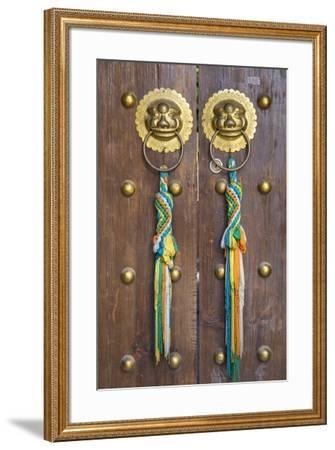 Door of guesthouse, Lijiang (UNESCO World Heritage Site), Yunnan, China-Ian Trower-Framed Photographic Print