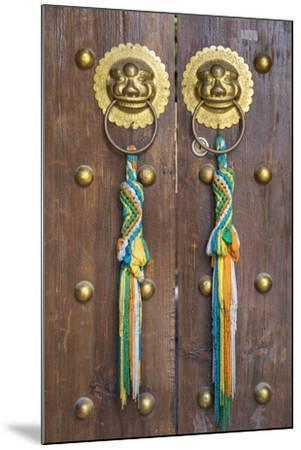Door of guesthouse, Lijiang (UNESCO World Heritage Site), Yunnan, China-Ian Trower-Mounted Photographic Print