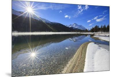 Rays of winter sun illuminate Lake Silvaplana still partially frozen Maloja Engadine Graubunden Can-ClickAlps-Mounted Photographic Print