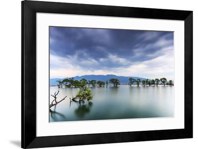 Sunset over one of the many lakes in the village of Heqing in Yunnan, China-ClickAlps-Framed Photographic Print