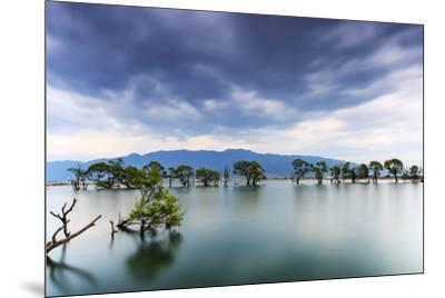 Sunset over one of the many lakes in the village of Heqing in Yunnan, China-ClickAlps-Mounted Photographic Print