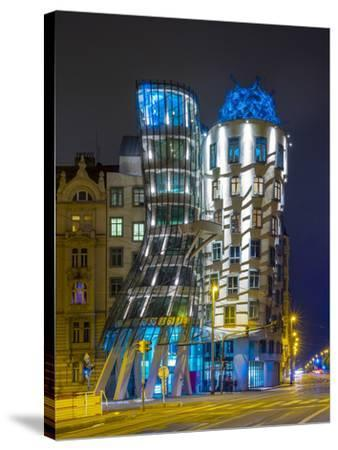 Czech Republic, Prague, Nove Mesto (New Town). Dancing House, Tancici dum, at night. Designed by Vl-Jason Langley-Stretched Canvas Print