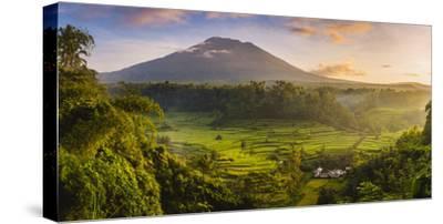 Sidemen valley, Rendang, Karangasem Regency, Bali, Indonesia. Paddy fields with Gunung Agung (Mt Ag-Marco Bottigelli-Stretched Canvas Print