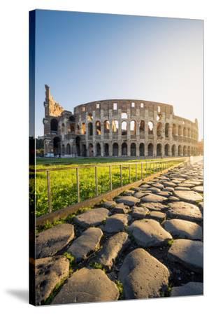 Rome, Lazio, Italy. Colosseum and Via Sacra (Sacred Road) at sunrise.-Marco Bottigelli-Stretched Canvas Print
