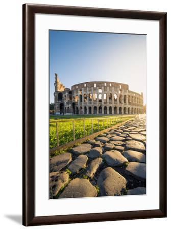 Rome, Lazio, Italy. Colosseum and Via Sacra (Sacred Road) at sunrise.-Marco Bottigelli-Framed Photographic Print