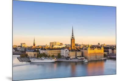 Stockholm, Sweden, Northern Europe. High angle view over Riddarholmen and Riddarholmskyrkan (church-Marco Bottigelli-Mounted Photographic Print