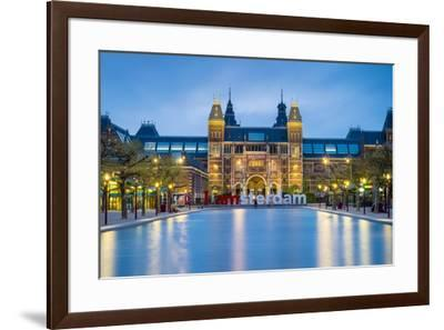 Netherlands, North Holland, Amsterdam. The Rijksmuseum on Museumplein at dusk.-Jason Langley-Framed Photographic Print