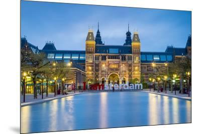 Netherlands, North Holland, Amsterdam. The Rijksmuseum on Museumplein at dusk.-Jason Langley-Mounted Photographic Print