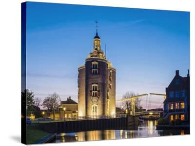 Netherlands, North Holland, Enkhuizen. Drommedaris tower, historic former city gate at the entrance-Jason Langley-Stretched Canvas Print