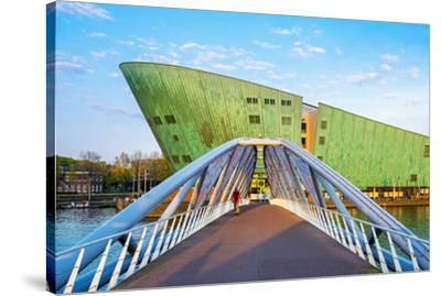 Netherlands, North Holland, Amsterdam. Science Center NEMO science museum, designed by Renzo Piano.-Jason Langley-Stretched Canvas Print