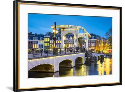 Netherlands, North Holland, Amsterdam. Magere Brug, Skinny Bridge, on the Amstel River at night.-Jason Langley-Framed Photographic Print