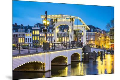 Netherlands, North Holland, Amsterdam. Magere Brug, Skinny Bridge, on the Amstel River at night.-Jason Langley-Mounted Photographic Print