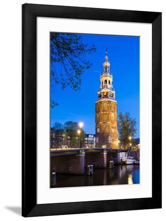 Netherlands, North Holland, Amsterdam. 16th century Montelbaanstoren tower on Oudeschans canal.-Jason Langley-Framed Photographic Print