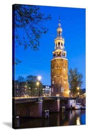 Netherlands, North Holland, Amsterdam. 16th century Montelbaanstoren tower on Oudeschans canal.-Jason Langley-Stretched Canvas Print