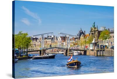 Netherlands, North Holland, Haarlem. A boat in front of the Gravestenenbrug drawbridge on the Spaar-Jason Langley-Stretched Canvas Print