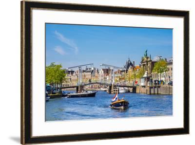 Netherlands, North Holland, Haarlem. A boat in front of the Gravestenenbrug drawbridge on the Spaar-Jason Langley-Framed Photographic Print