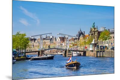 Netherlands, North Holland, Haarlem. A boat in front of the Gravestenenbrug drawbridge on the Spaar-Jason Langley-Mounted Photographic Print