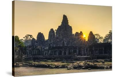 Prasat Bayon temple ruins at sunrise, Angkor Thom, UNESCO World Heritage Site, Siem Reap Province, -Jason Langley-Stretched Canvas Print