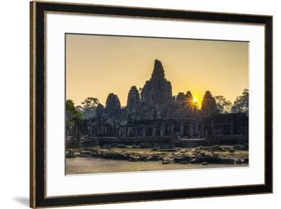Prasat Bayon temple ruins at sunrise, Angkor Thom, UNESCO World Heritage Site, Siem Reap Province, -Jason Langley-Framed Photographic Print