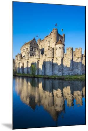 Belgium, Flanders, Ghent (Gent). Gravensteen castle, 12th century medieval castle on the Leie River-Jason Langley-Mounted Photographic Print