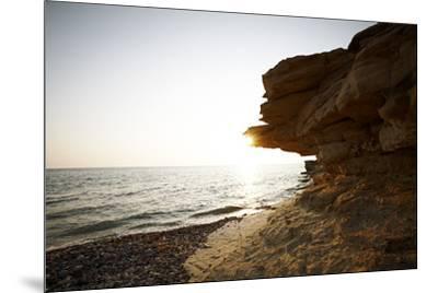 Sundown on the stone beach island Kos, Greece,-Rasmus Kaessmann-Mounted Photographic Print