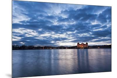 View to the illuminated castle Moritzburg, Saxony, in the early evening hours, blue hour with unusu-UtArt-Mounted Photographic Print