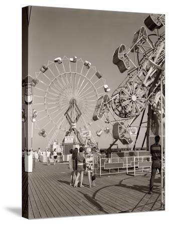 1960s Group of Teens Looking at Amusement Rides on Pier--Stretched Canvas Print