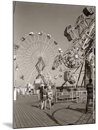 1960s Group of Teens Looking at Amusement Rides on Pier--Mounted Photographic Print