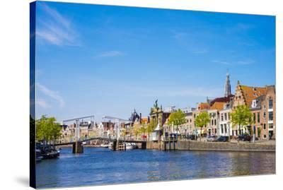 Buildings along the Spaarne River with Gravestenenbrug drawbridge, Haarlem, North Holland, Netherla-Jason Langley-Stretched Canvas Print
