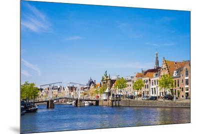 Buildings along the Spaarne River with Gravestenenbrug drawbridge, Haarlem, North Holland, Netherla-Jason Langley-Mounted Photographic Print