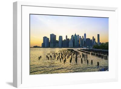 Lower Manhattan skyline across the East River at sunset, New York City, New York, United States of -Fraser Hall-Framed Photographic Print