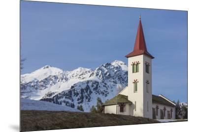 The white alpine church framed by snowy peaks, Maloja, Bregaglia Valley, Canton of Graubunden, Enga-Roberto Moiola-Mounted Photographic Print