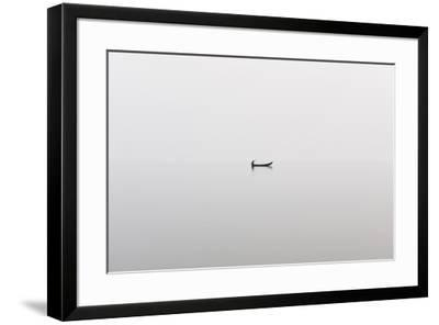 A fishing boat on a perfectly calm Indawgyi Lake in northern Myanmar on a misty afternoon, Myanmar-Alex Treadway-Framed Photographic Print