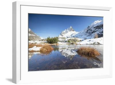 Snowy peaks are reflected in the alpine lake partially frozen, Lejets Crap Alv (Crap Alv Laiets), C-Roberto Moiola-Framed Photographic Print