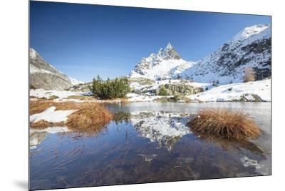 Snowy peaks are reflected in the alpine lake partially frozen, Lejets Crap Alv (Crap Alv Laiets), C-Roberto Moiola-Mounted Photographic Print