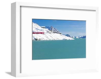 Bernina Express train in the snowy valley surrounded by Lake Bianco, Bernina Pass, Canton of Graubu-Roberto Moiola-Framed Photographic Print