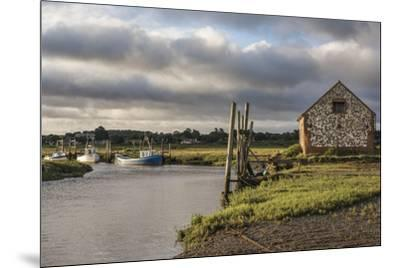 A view of boats moored in the creek at Thornham, Norfolk, England, United Kingdom, Europe-Jon Gibbs-Mounted Photographic Print