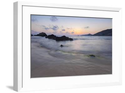 The last lights of the sunset are reflected on sea waves and sandy beach, Licata, Province of Agrig-Roberto Moiola-Framed Photographic Print